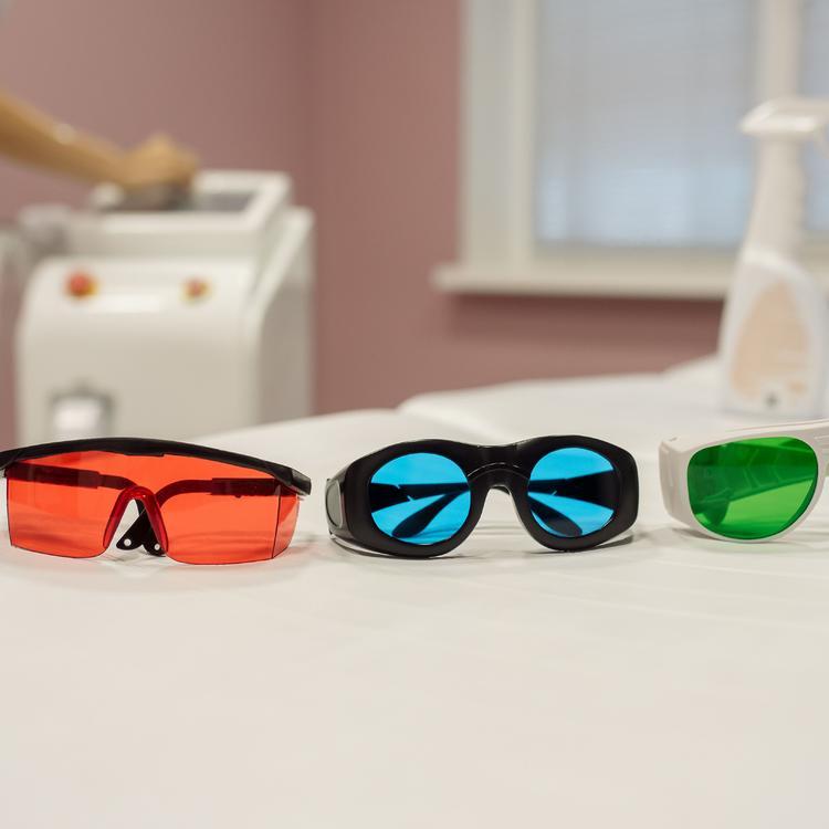 laser and absorbing dye lenses